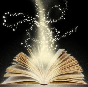 Magic book with bright light coming from its open pages